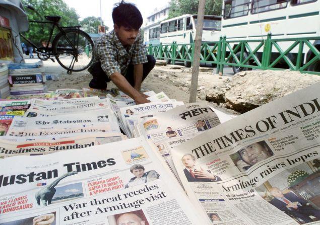 Vendeur de journaux en Inde